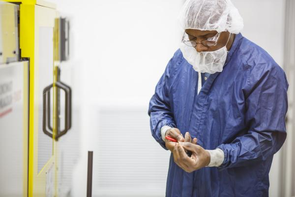 Engineering Technician William Taylor performs a process validation for a medical component in the molding clean room.
