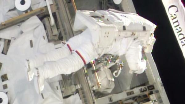 A spacewalker works on the S0 truss after replacing a failed backup computer.