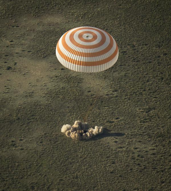 The Soyuz TMA-11M spacecraft is seen as it lands.