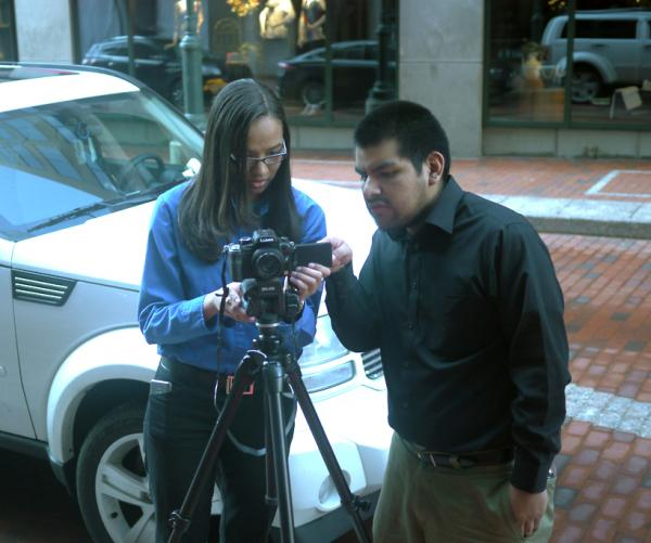 Student Greidy and Learning Lab fellow Frank Wallace work with a camera on Pratt Street.