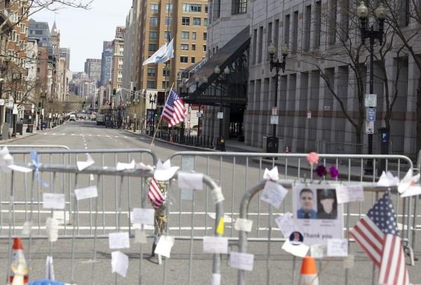 A memorial to the victims of the Boston Marathon bombing at Boylston and Hereford Streets in Boston on April 22, 2013.