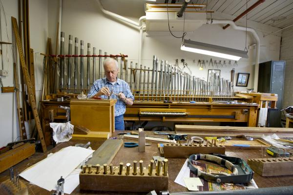 Daniel Kingman, head flue voicer and reed voicer at Austin Organs, works to restore the French trumpet from an organ in Cincinnati.