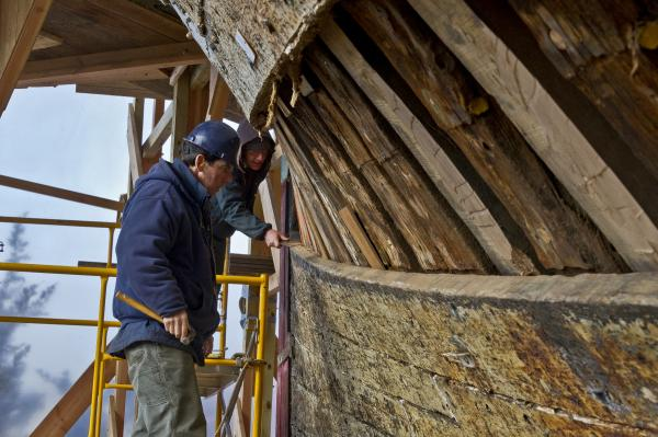 Shipwrights working on the Charles W. Morgan's hull in March, 2012.