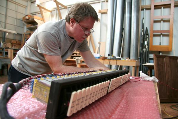 Raymond Albright testing knobs at Austin Organs.