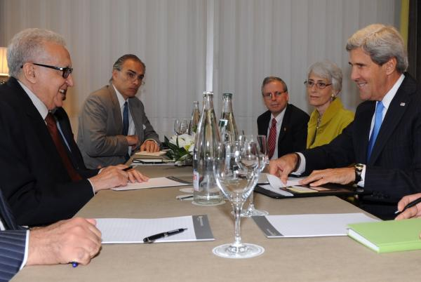 U.S. Secretary of State John Kerry, Undersecretary Wendy Sherman, and U.S. Ambassador to Syria Robert Ford sit with United Nations and Arab League Special Envoy to Syria, Lakdhar Brahimi, before a meeting in Geneva, Switzerland, on September 12, 2013.