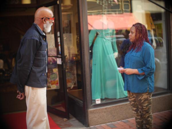 Student Nardia interviews Joe Jones on Pratt Street.