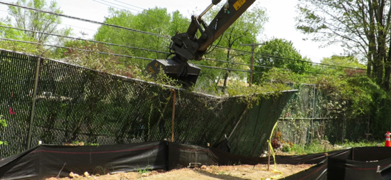 A fence between New Haven and Hamden comes down.