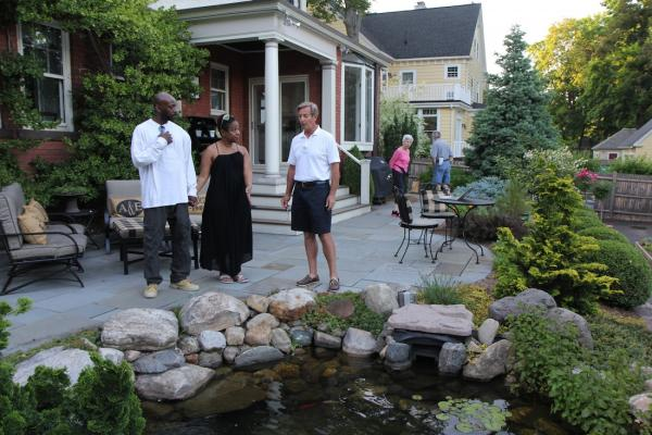 Avery Buell (center), with Hartford Blooms attendees Antonio and Shay, in his West End back yard.