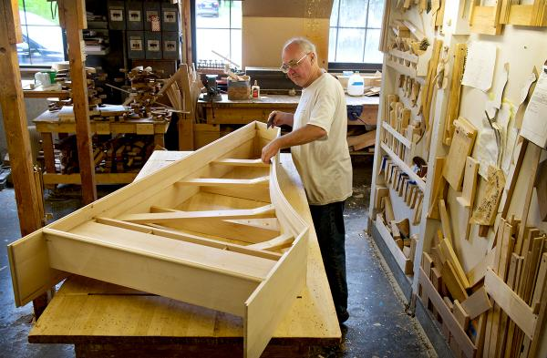 The structure of a harpsichord comes together at the hand of Stuart McCormack.