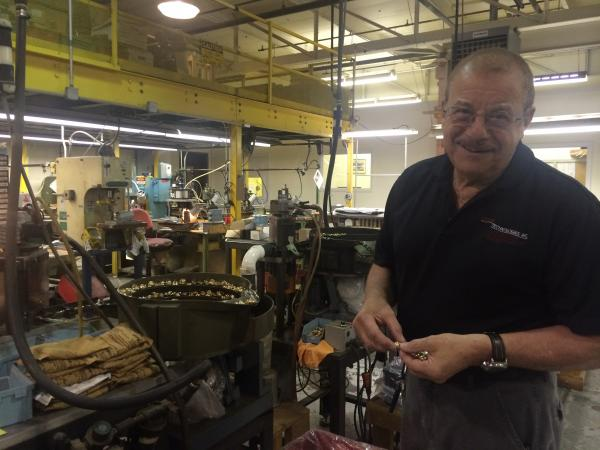 Sal Geraci of the Waterbury Button Company in Cheshire demonstrates how specialty buttons are made.