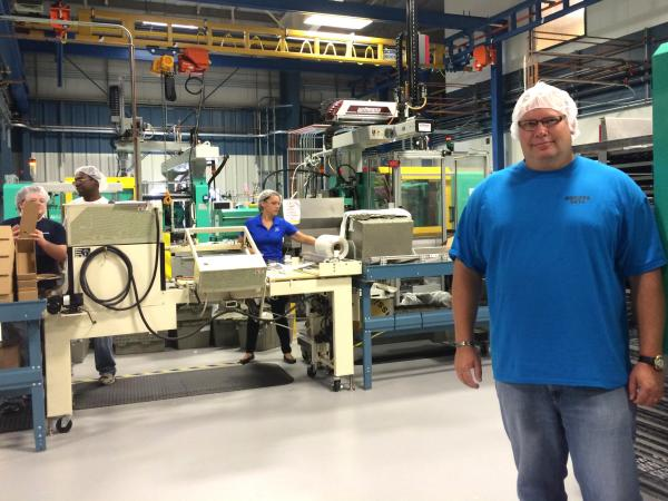 Norm Forest, CEO of Dymotek Corp. in Ellington, says the company is one of only about six manufacturers in the U.S. to injection mold two or more materials.