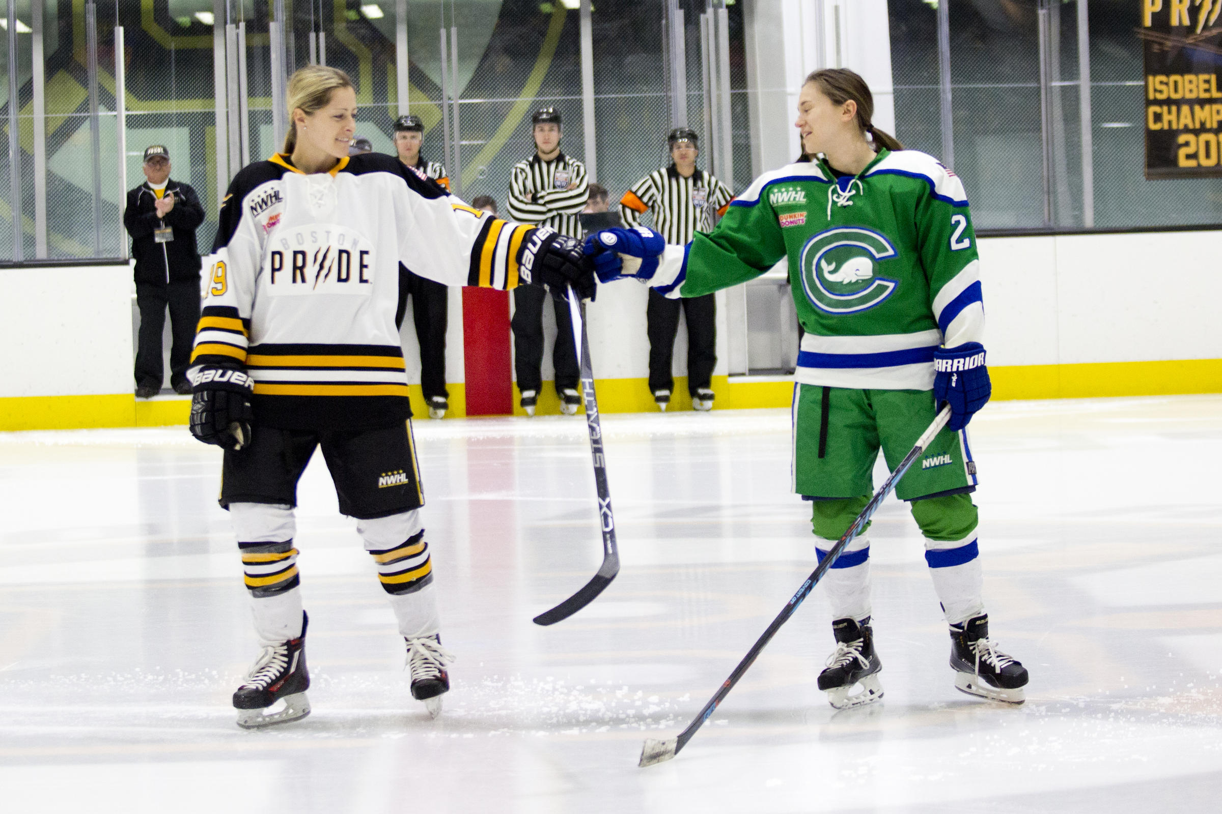 Team USA players from opposite sides came together before Thursday s  National Women s Hockey League semi-final d00ae4926