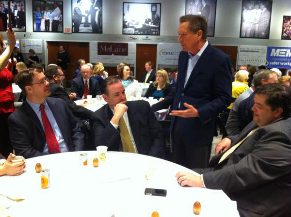 John Kasich talks with attendees at Politics & Eggs in New Hampshire Tuesday morning.