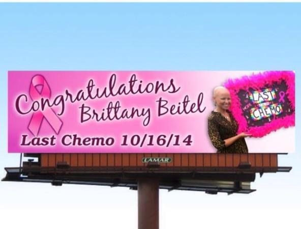 A billboard recognizes Brittany Beitel's last day of Chemo. Beitel was diagnosed with breast cancer at the age of 26.