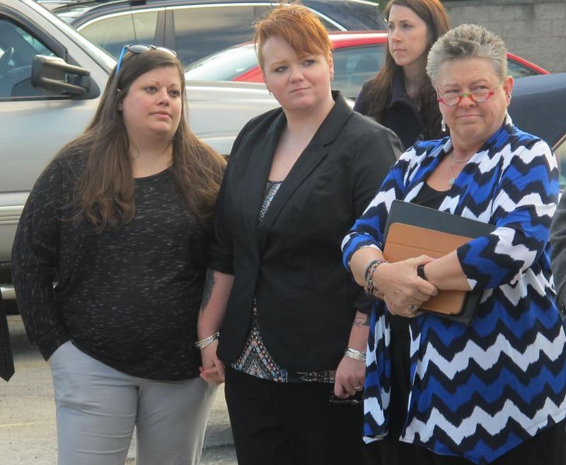 Jerra Knicely (L), Jenn Moffitt and their lawyer, Carol Ann Fey (R), attend a rally before a Bexley City Council meeting.