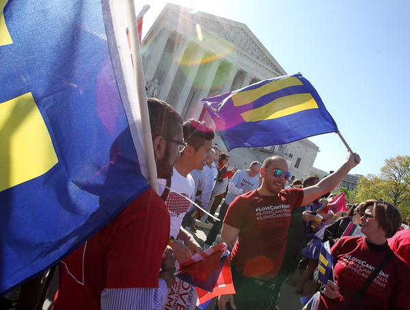 Same-sex marriage supporters gather outside the U.S. Supreme Court