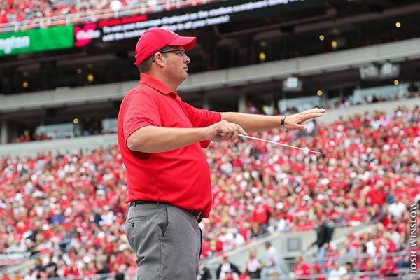 Jon Waters conducts the Ohio State Alumni Marching Band