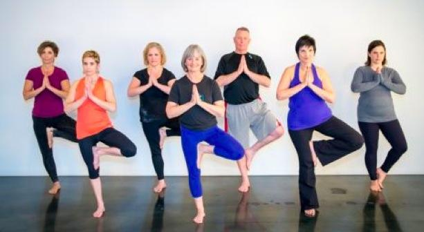 Tree Pose demonstrated by teachers from Yoga on High.