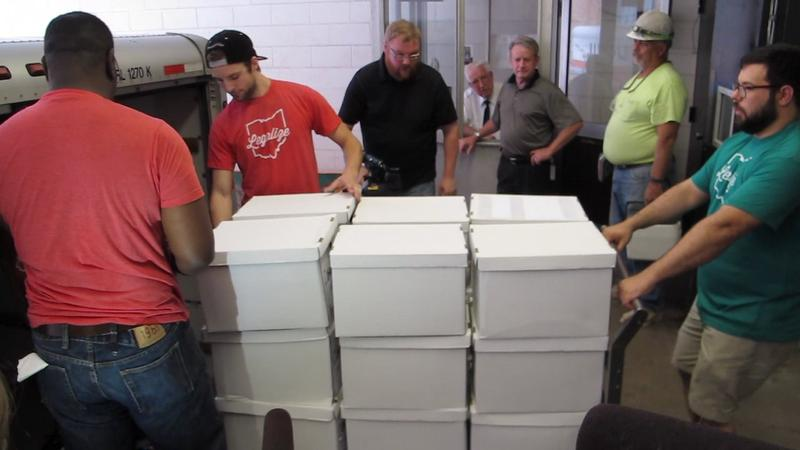 Supporters of legalized marijuana deliver boxes of petitions to the Ohio Secretary of State's Office