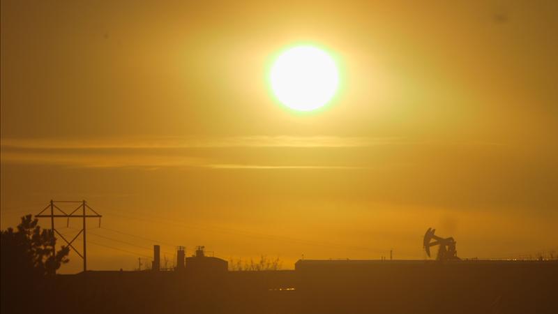 Sunset over an oil field