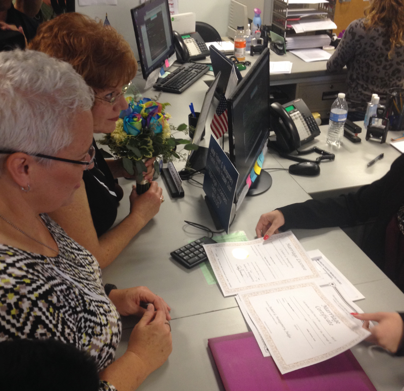 Mindy Ross (left) and Jimmie Beall get a first look at their marriage license at Franklin County Probate Court. They were the first same-sex couple in the county to receive a marriage license.