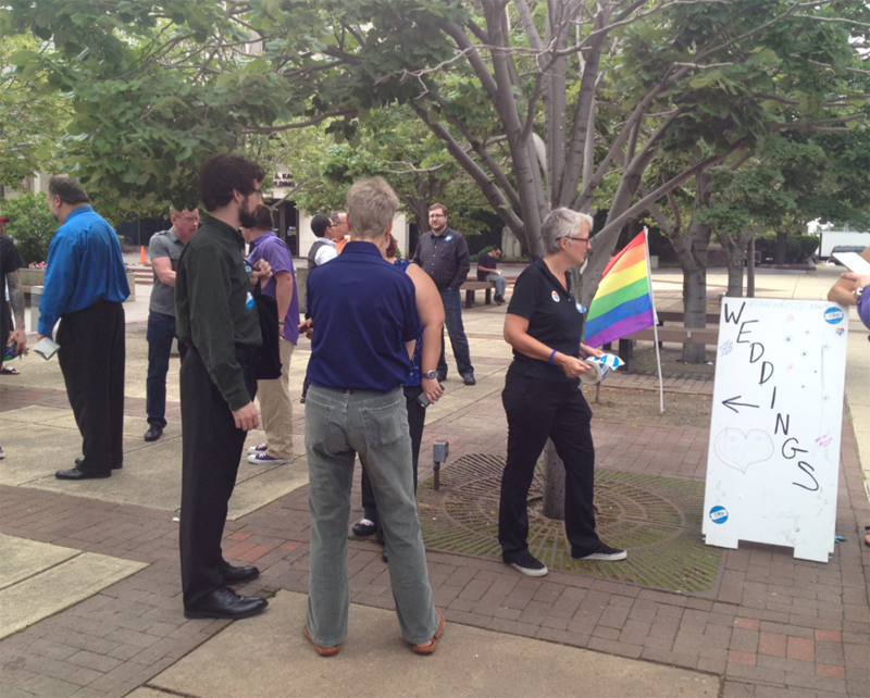 Members of Equality Ohio set up an area across from the Franklin County Courthouse where same-sex couples, who receive their marriage licenses today, can get married for free by local ordained ministers.