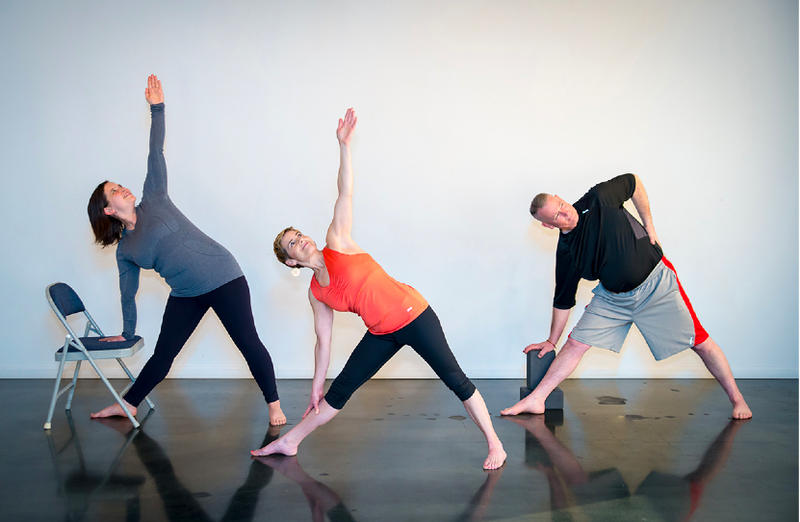 Teachers from Yoga on High demonstrate Triangle Pose as part of the downloadabe sequence.