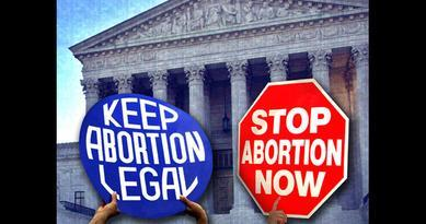 Abortion protest signs