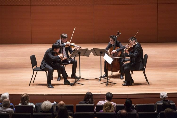 color photogaph of quartet Sensa Misura performing at Alice Tully Hall
