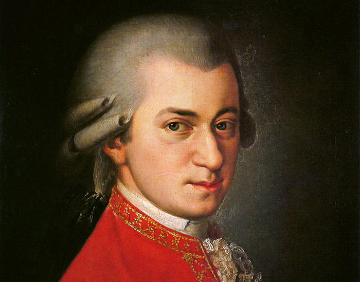 color image of a portrait of Mozart in which he wears a bright red suit
