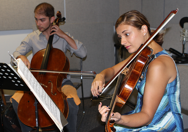 Violist Milena Pajaro-van de Stadt (right) and cellist Camden Shaw of the Dover Quartet playing their instruments.