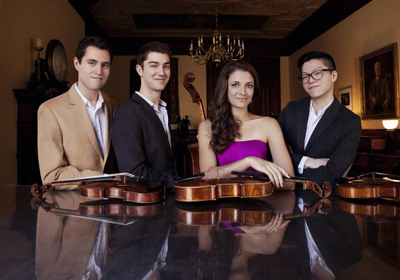 color photo of the Dover Quartet with their instruments