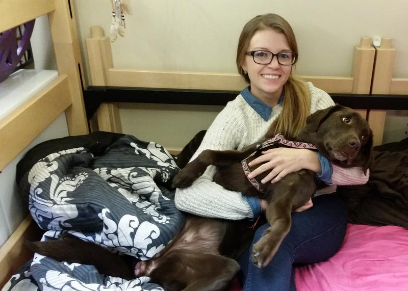 Otterbein student Lauren Becks and Belle in their dorm room