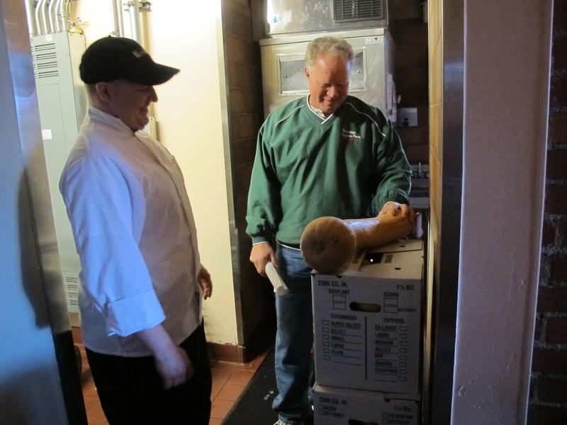 Mike Laughlin (R) delivers organic butternut squash to a Short North restaurant.