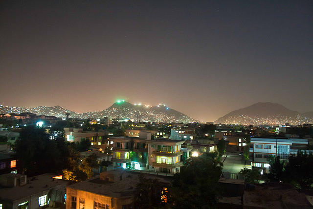 color photo of a night shot of Kabul, showing city lights and mountains