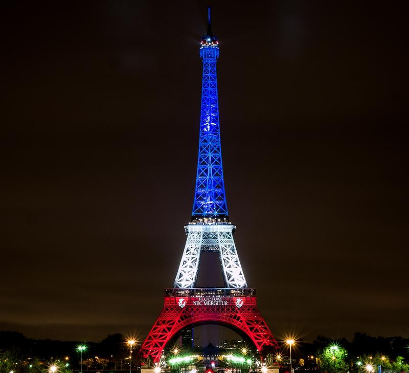 Eiffel Tower lights up in red, white, and blue after ISIS terrorist attacks.