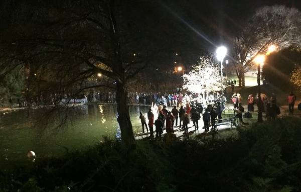 Ohio State students at the Mirror Lake jump on Tuesday evening prior to a tragic event which led to the death of a man.