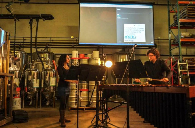 color photo of bass clarinetist Amy Advocat and marimbist Matt Sharrock playing in front of beer vats