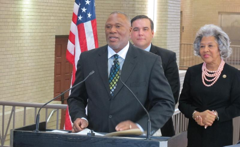 Steve Francis, Columbus' first chief diversity officer, speaks to a press conference on Tuesday. Behind him are Mayor Andrew Ginther and Congresswoman Joyce Beatty.