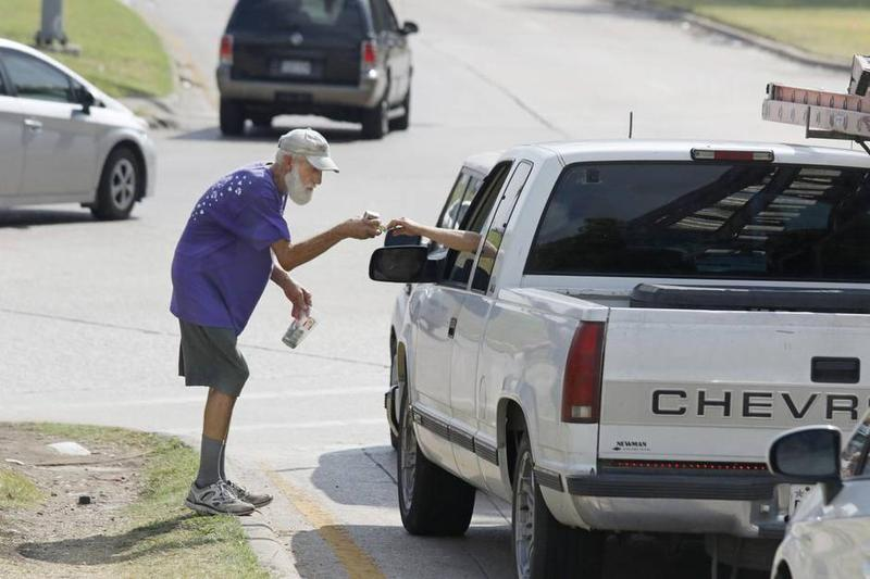 """The signs imply that panhandling is illegal citywide, but city code only prohibits """"aggressive"""" panhandling, and panhandling that impedes traffic."""