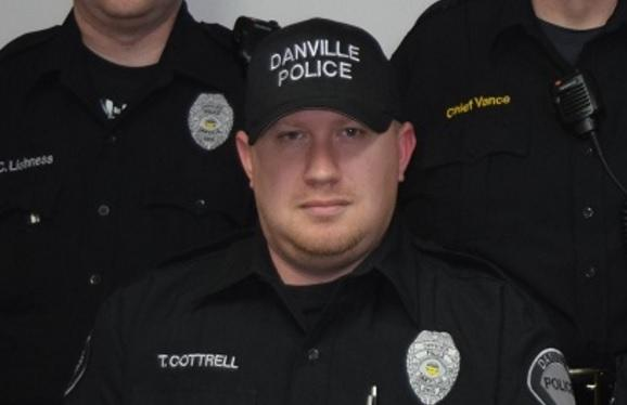 Authorities say Danville Officer Thomas Cottrell was found dead on the ground behind the Danville Municipal Building and his service weapon had been taken.