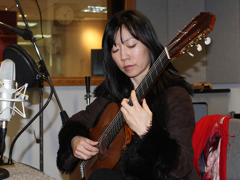 color photo of Xuefei Yang playing guitar in Classical 101 studio