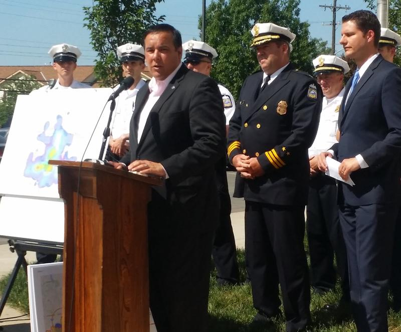 Columbus mayor Andrew Ginther announces the rollout of the Community Safety Initiative for 2016.  Beside him, police commander Gary Cameron, city council president Zach Klein