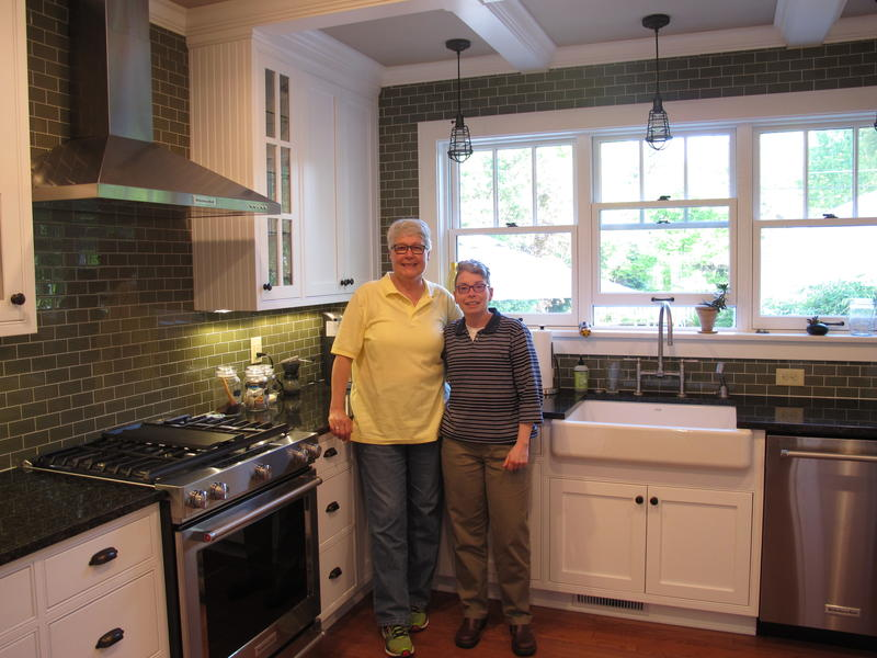 Mary Kennett (L) and Janet Stackpole renovated their Clintonville home without the help of a tax abatement. They say such a tax break would have helped them replace their house's failing foundation and perform other home improvements much sooner.