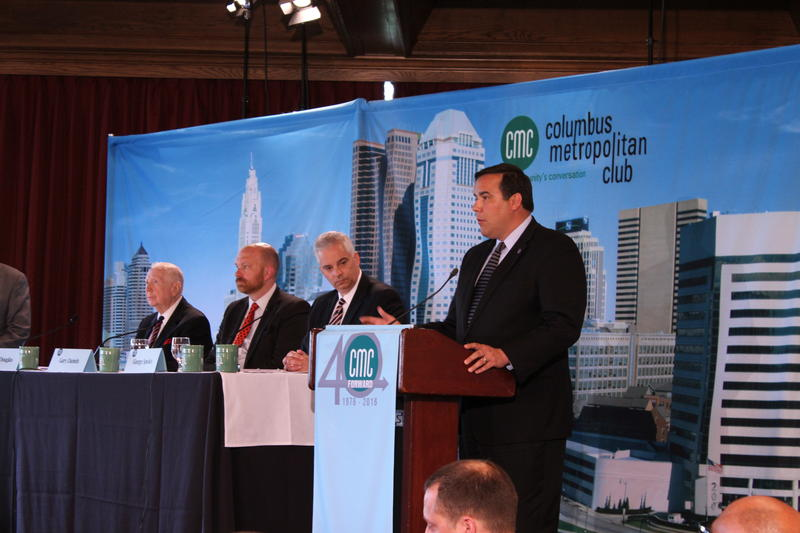"""Mayor Andrew Ginther (right) introduced the panel on """"police body cameras: benefits and challenges"""" From right: George Speaks, Director of Public Safety; Greg Daniels of the Ohio ACLU and Andy Douglas former Ohio Supreme Court Justice."""
