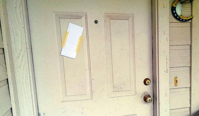 A notice posted on a tenant's door