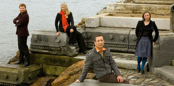 color photo of the members of the Cypress Quartet standing outdoors on stone steps