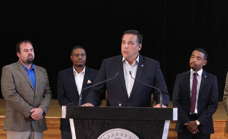 At the Westgate Recreation Center, Mayor Andrew Ginther and city councilmember Shannon Hardin stand with other city leaders to annouce plans for a charter review committee.