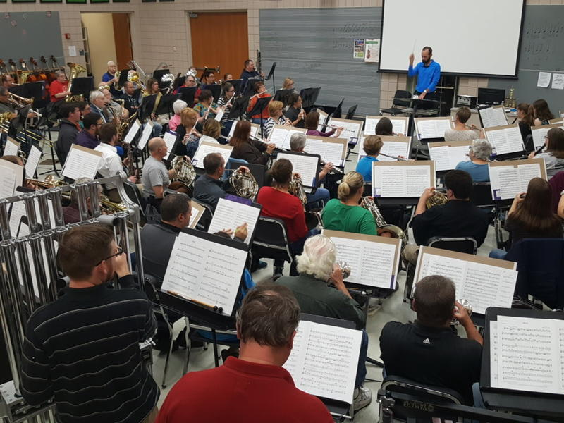 color photo taken from behind the musicians of the Dublin Win Symphony during a rehearsal