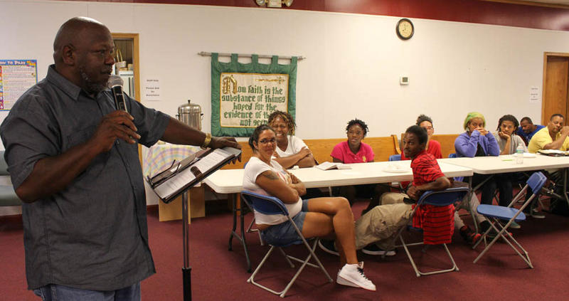 Mitchell Ellison leads a Bible study at the Crack House Ministries on Cleveland Avenue.